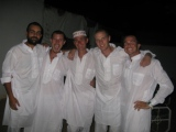 5 men in white clothes